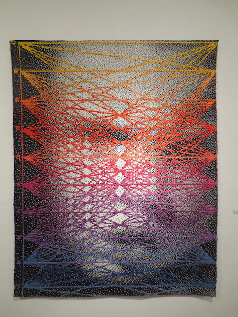 """Positivity Su Data"" (2014), by Lia Cook. Woven cotton and rayon. Berkeley Art Center."