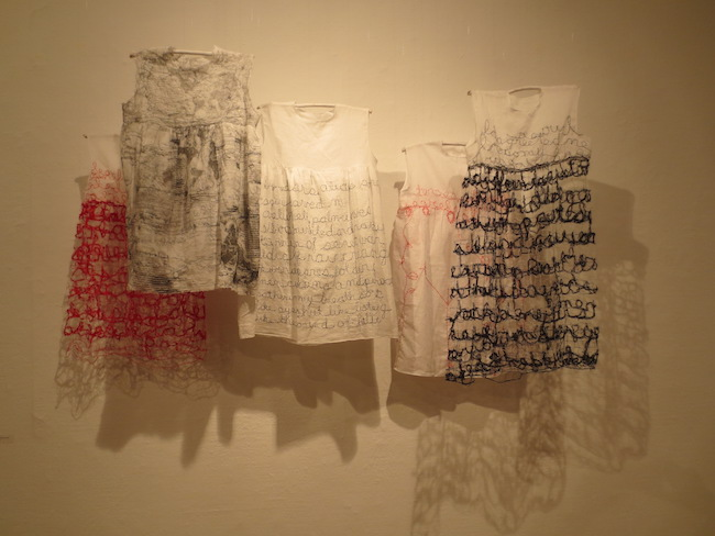 """Little Memoir Dresses"" (2016), by Laura Raboff. Cotton, thread. Berkeley Art Center."
