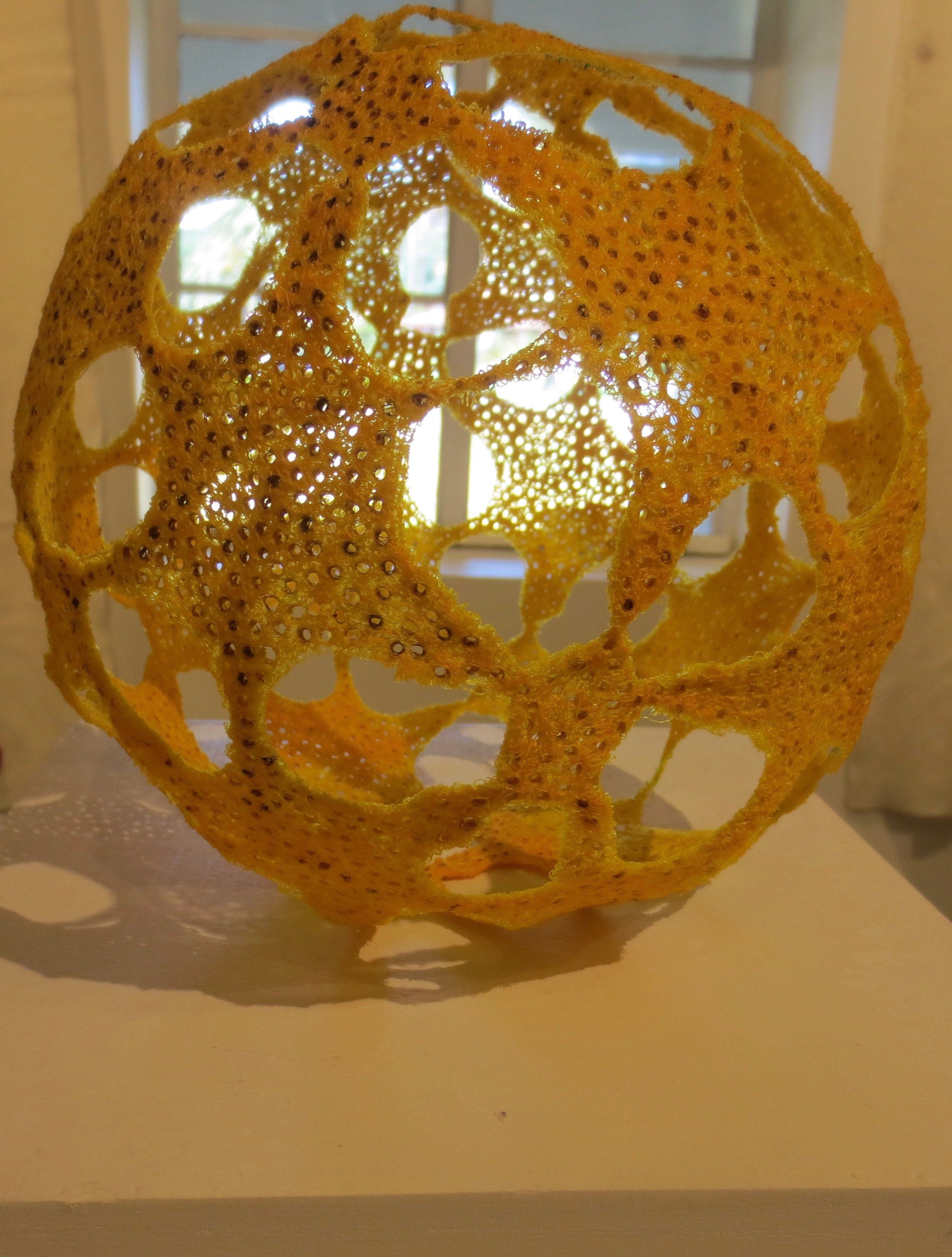 """Yellow Polyhedron,"" by Marty Jonas. Thread. Marin MOCA."