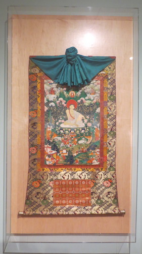 """Milarepa"" (18th c., Tibet). Opaque pigments and gold on textile. This portrait was the first of what was once a set of 19 thangkas. The composition relates a Buddhist teaching lineage as well as the first important scenes from the life of Milarepa life (1052-1135), one of Tibet's most famous yogi/saints and poets."
