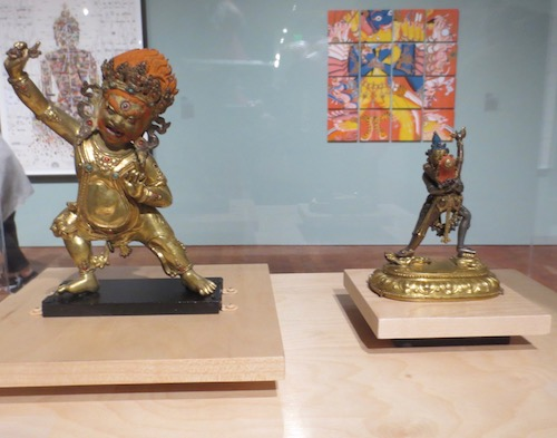 On the right, Sahaja Cakrasamvara with Vajravarahi (16th c., Tibet), silver, copper and gilt-copper. On the left, Vajrapani (16th c., Tibet), represents an unwavering ability to vanquish negativity.