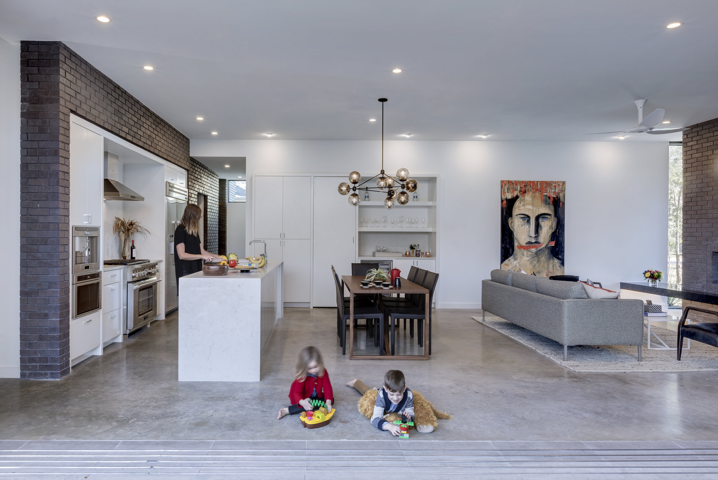 01 Living-Dining-Kitchen_Main Stay House by Matt Fajkus Architecture_Photo 1 by Charles Davis Smith.jpg