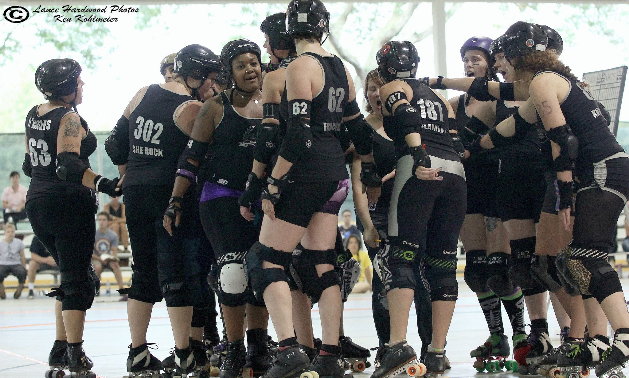 """Brawlstars get psyched up before playing Grand Raggidy Roller Girls, August 2, 2014 at Buhr Park. /  """"Lance Hardwood"""" Photos"""
