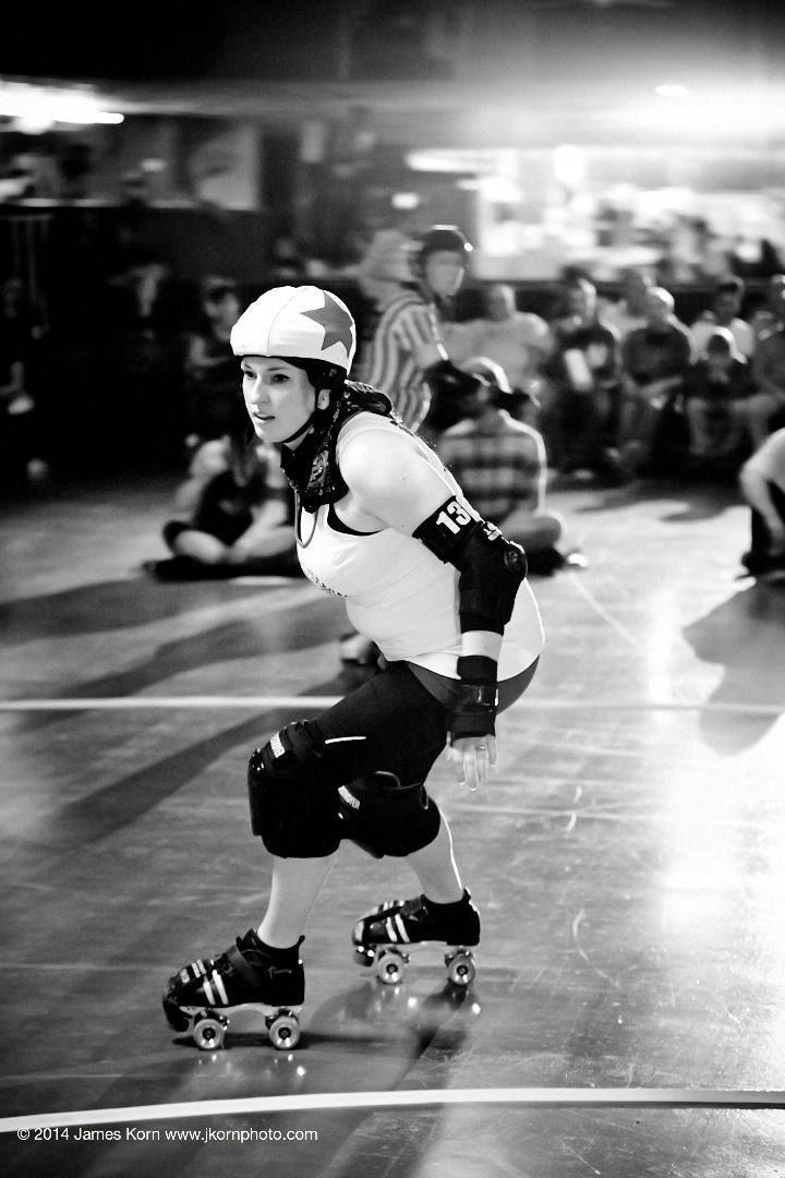 SJ jams against South Bend Roller Girls' Bonnie Dooms, April 14, 2014. Photo by  JKorn Photographics