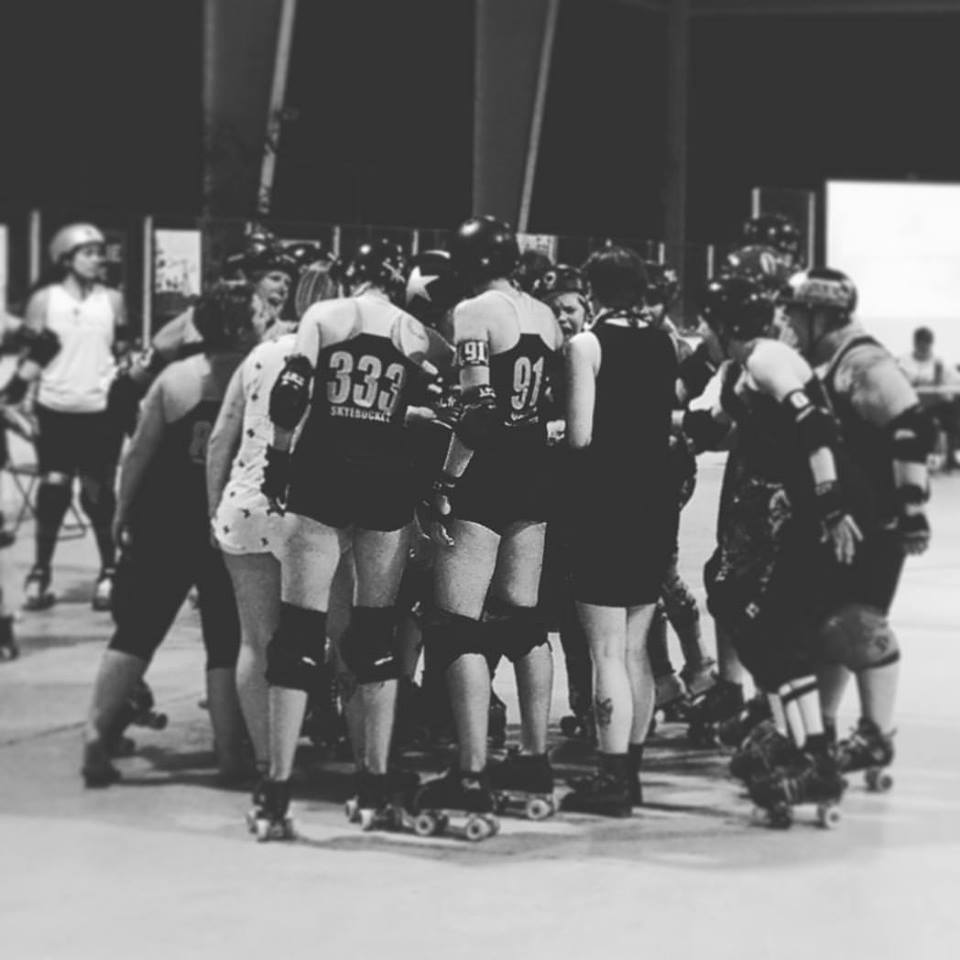 Ypsilanti Vigilantes huddle up during their last home game of 2016, August 6 at Buhr Park. Photo by Bear-a-Cuda.