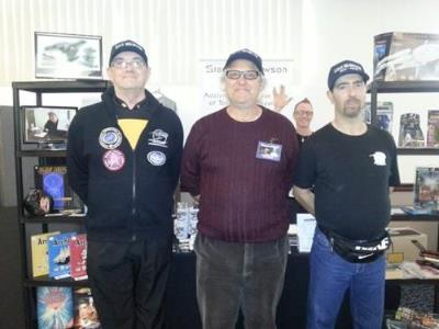 September 15, Club members - Roy, George, Rob and a cheeky Vulcan salute from Stu in the background at our expo area at the Star Trek - Buck Rogers convention in Adelaide.