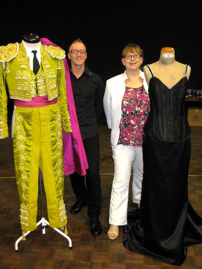"""April 23 """"Behind the scenes"""" meet-up at SA Opera Company for Opera Encore, a unique opportunity for fans to view the fantastic costumes, props and models as well as some wonderful singing for the upcoming production of La Traviata!  (Cherie and Stu are tucked in between some exquisite costumes!)"""