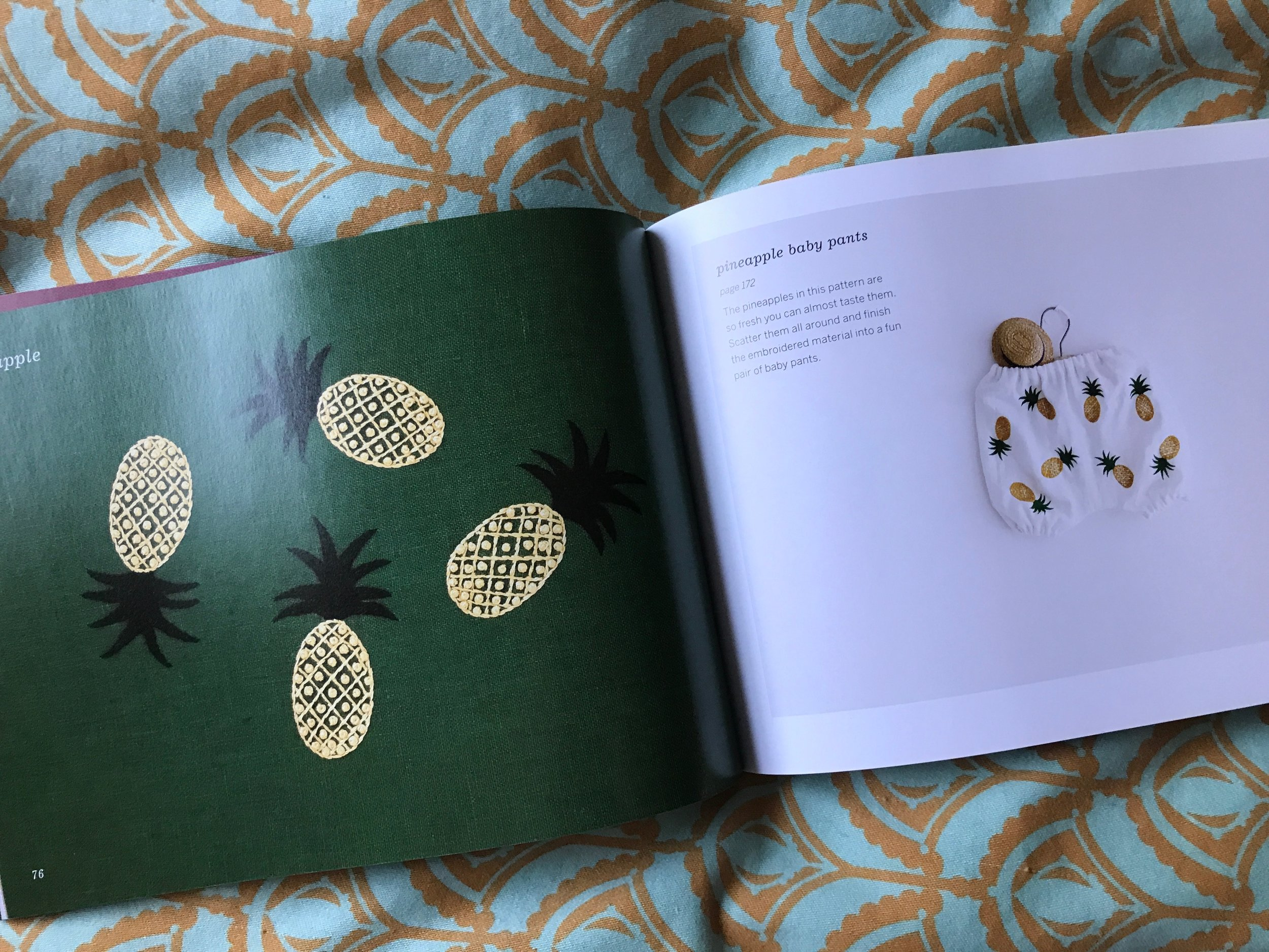"""Have you been seeing pineapples everywhere in home decor lately? The pineapple has long been seen as a traditional expression of """"welcome"""" in a home! A single pineapple in a small hoop would have big impact for a friend or entryway. Eight pineapples on a pair of baby bloomers is pretty sweet welcome to the world!"""
