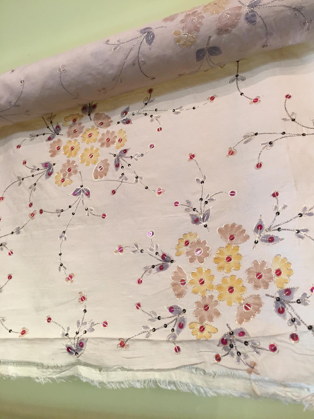 Painted and sequin-ed silk. Oooh, la, la.