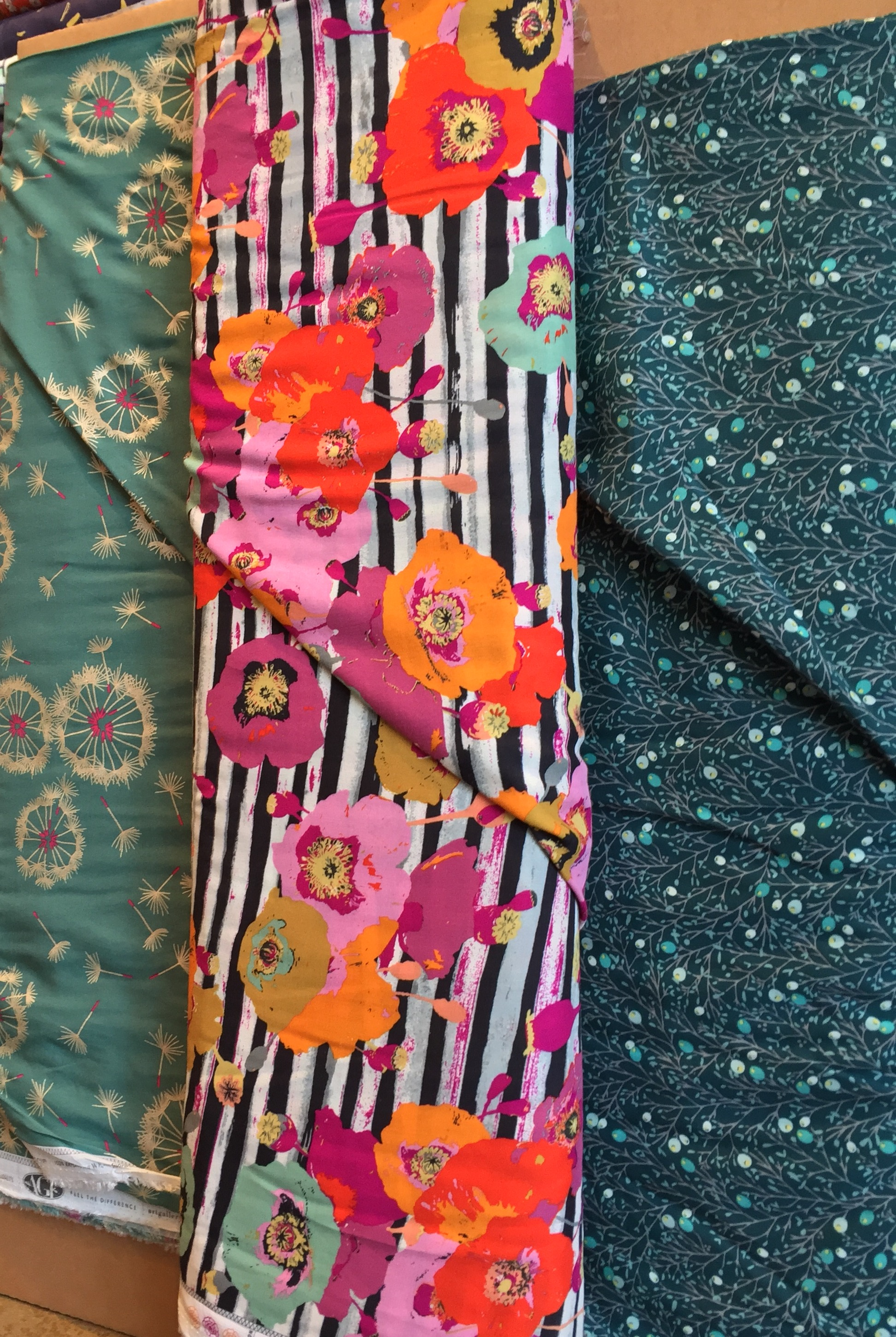 Lovely stretch cotton in a summery, light weight with metallic accents, and two luscious rayons.