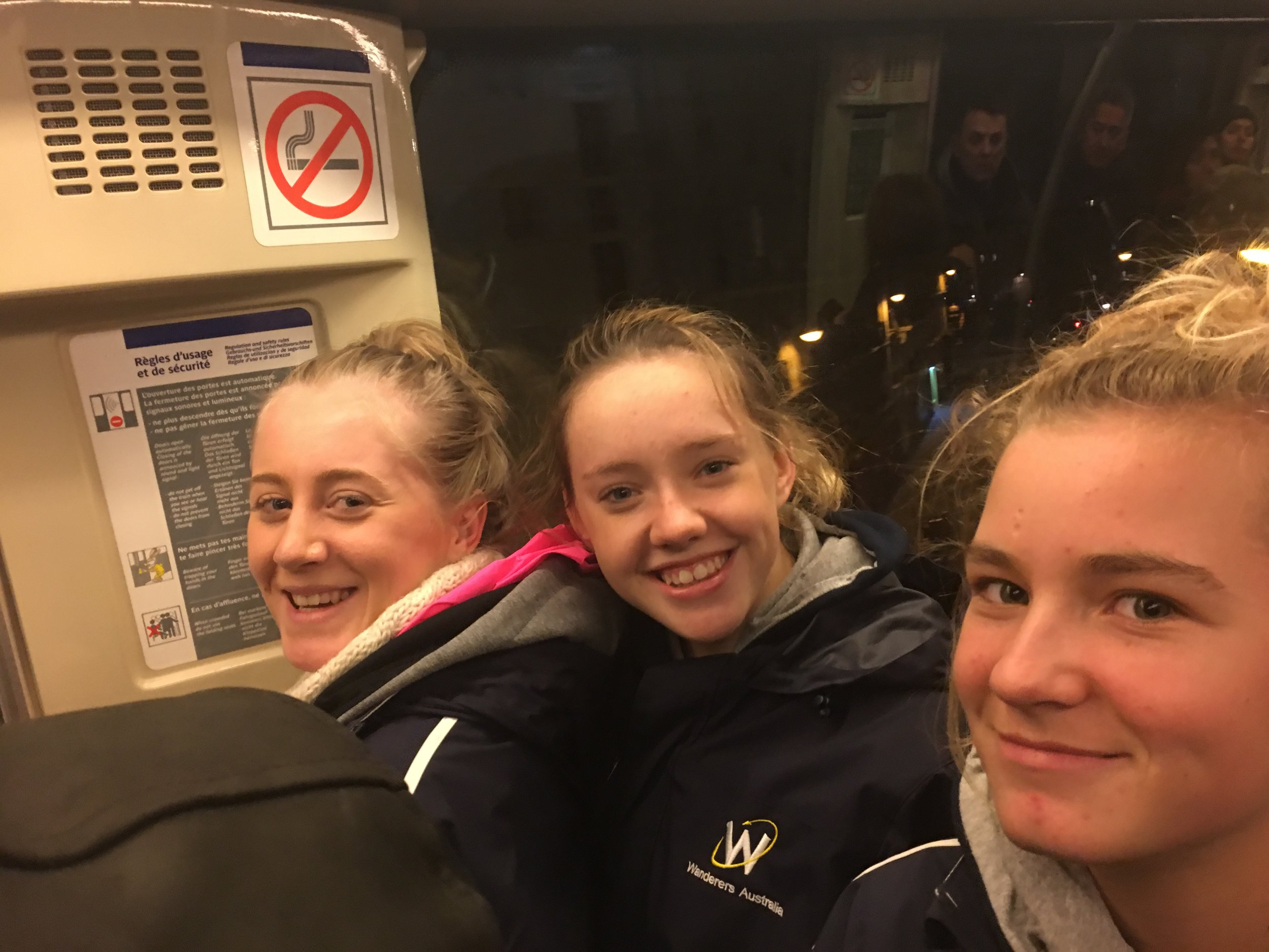Girls cramming into the train - packed in like sardines