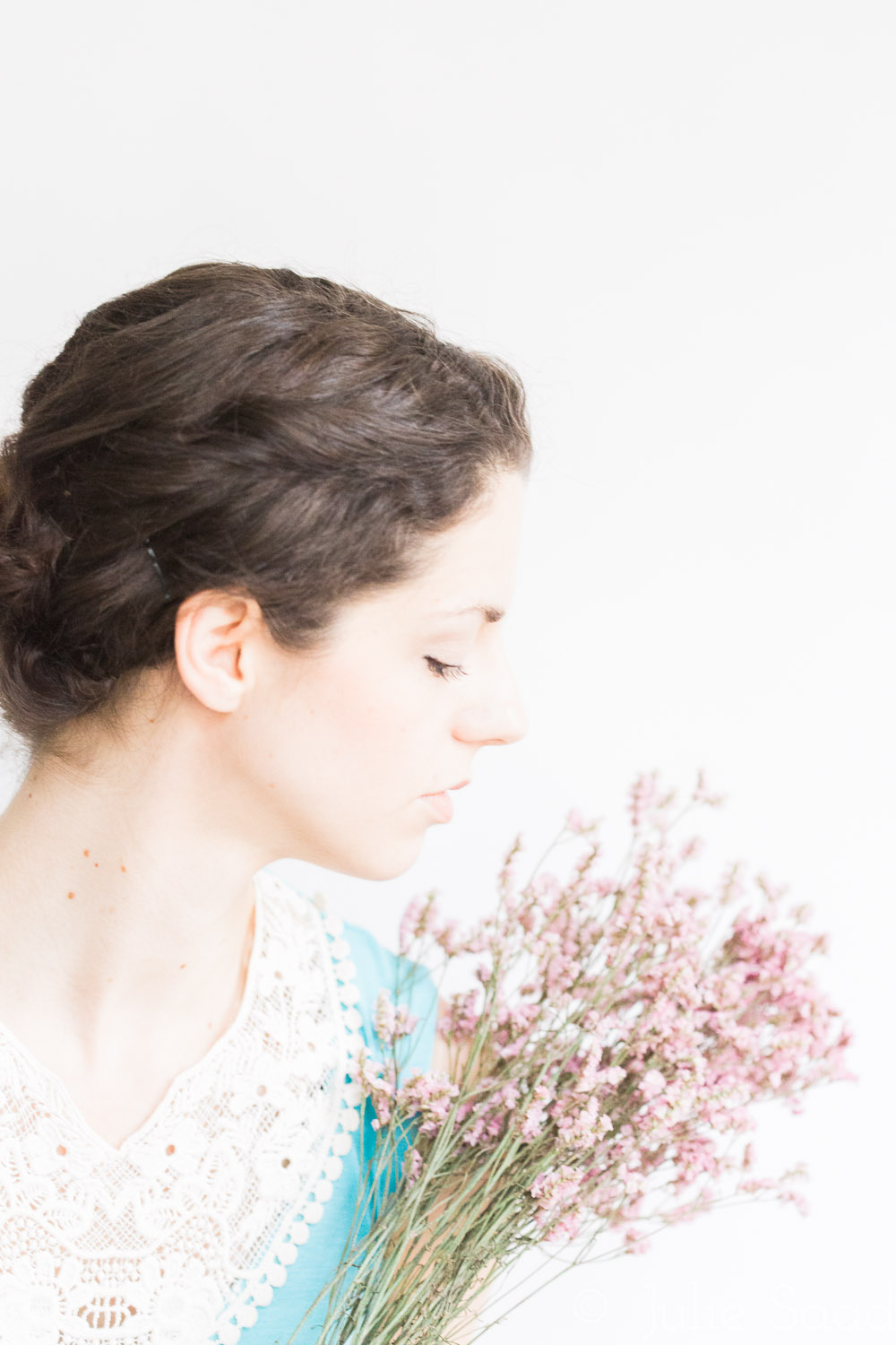profile of bride with pink flowers something blue