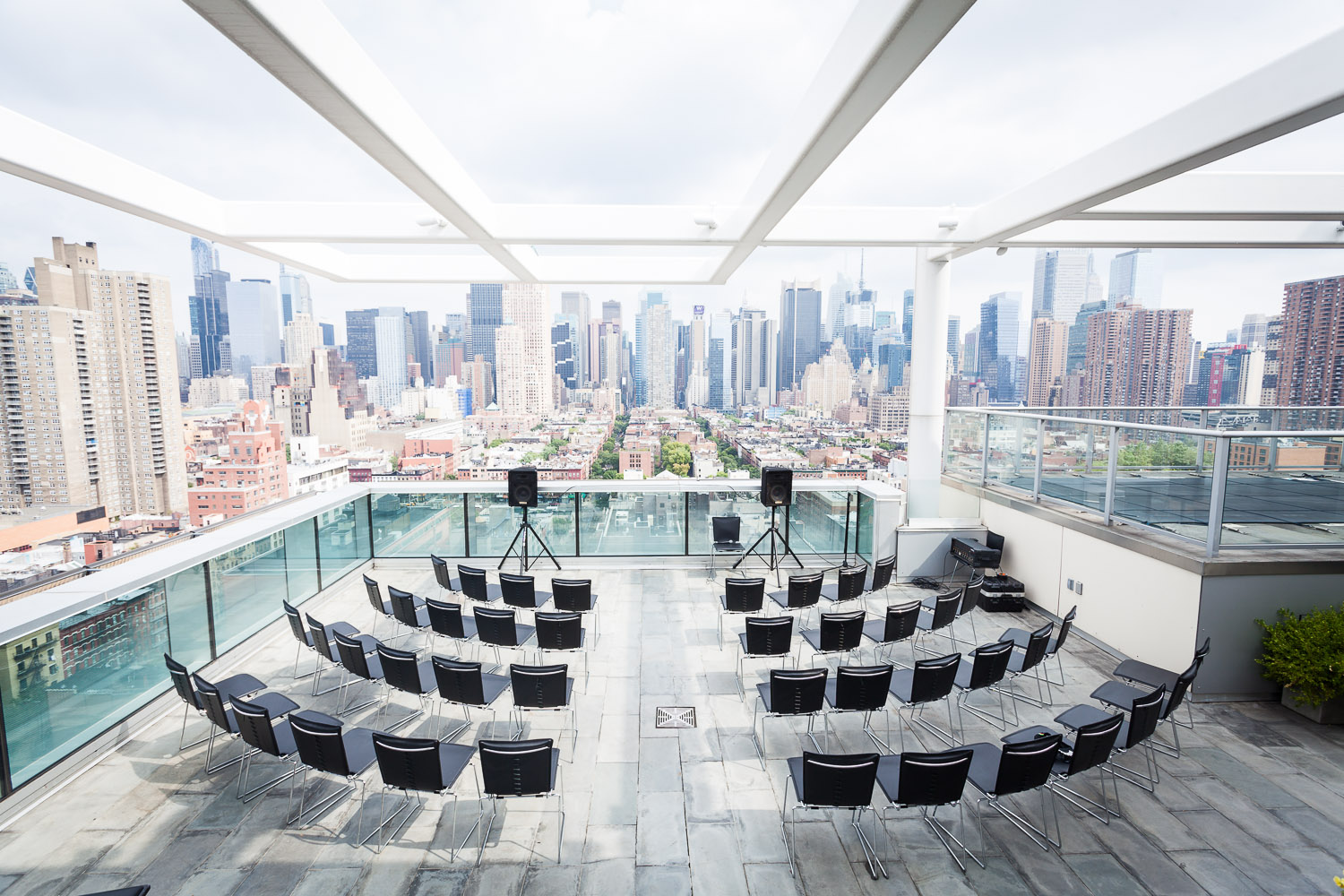 The ceremony set up at Ink 48 in Manhattan, New York. The couple opted for black chairs in a classic set up with a center aisle.