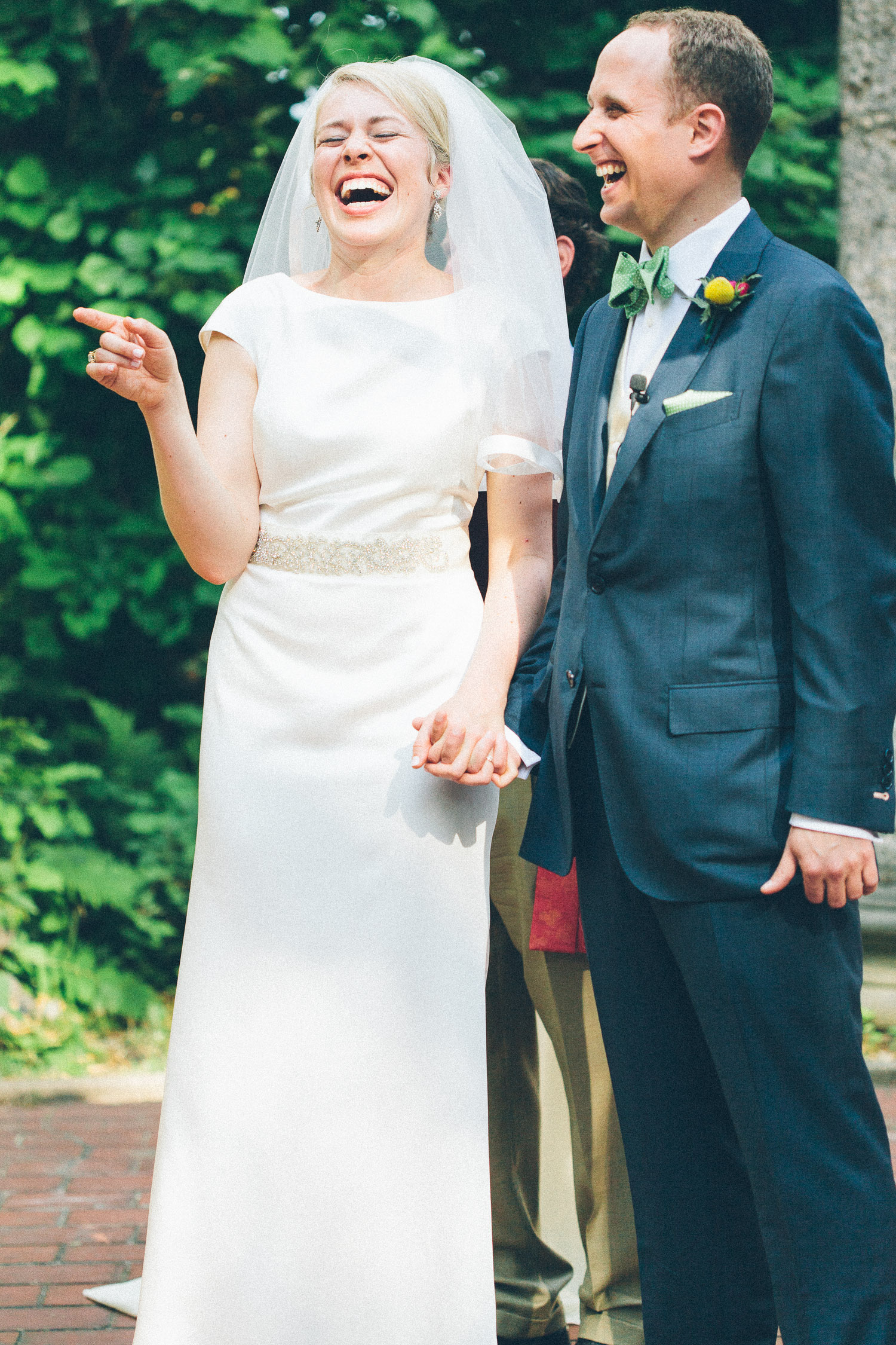 How cute is this couple? I love the groom's choice of a slate blue wedding suit and billy ball boutonniere. His green bow tie is adorable too! I love the beautiful bride's veil and unstoppable laugh. She looked no less than stunning.