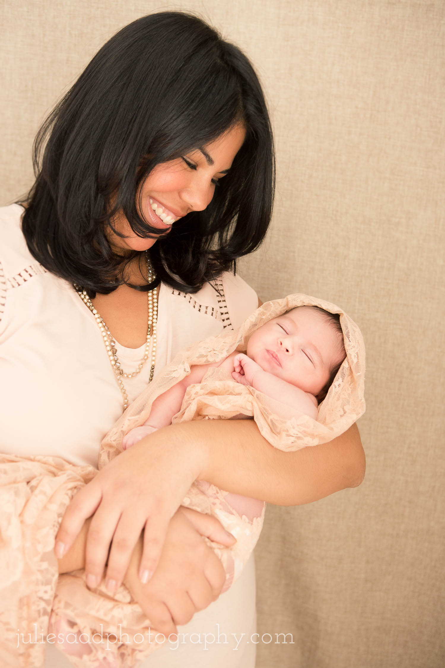 Mother and daughter, natural newborn photography by fine art photographer Julie Saad.