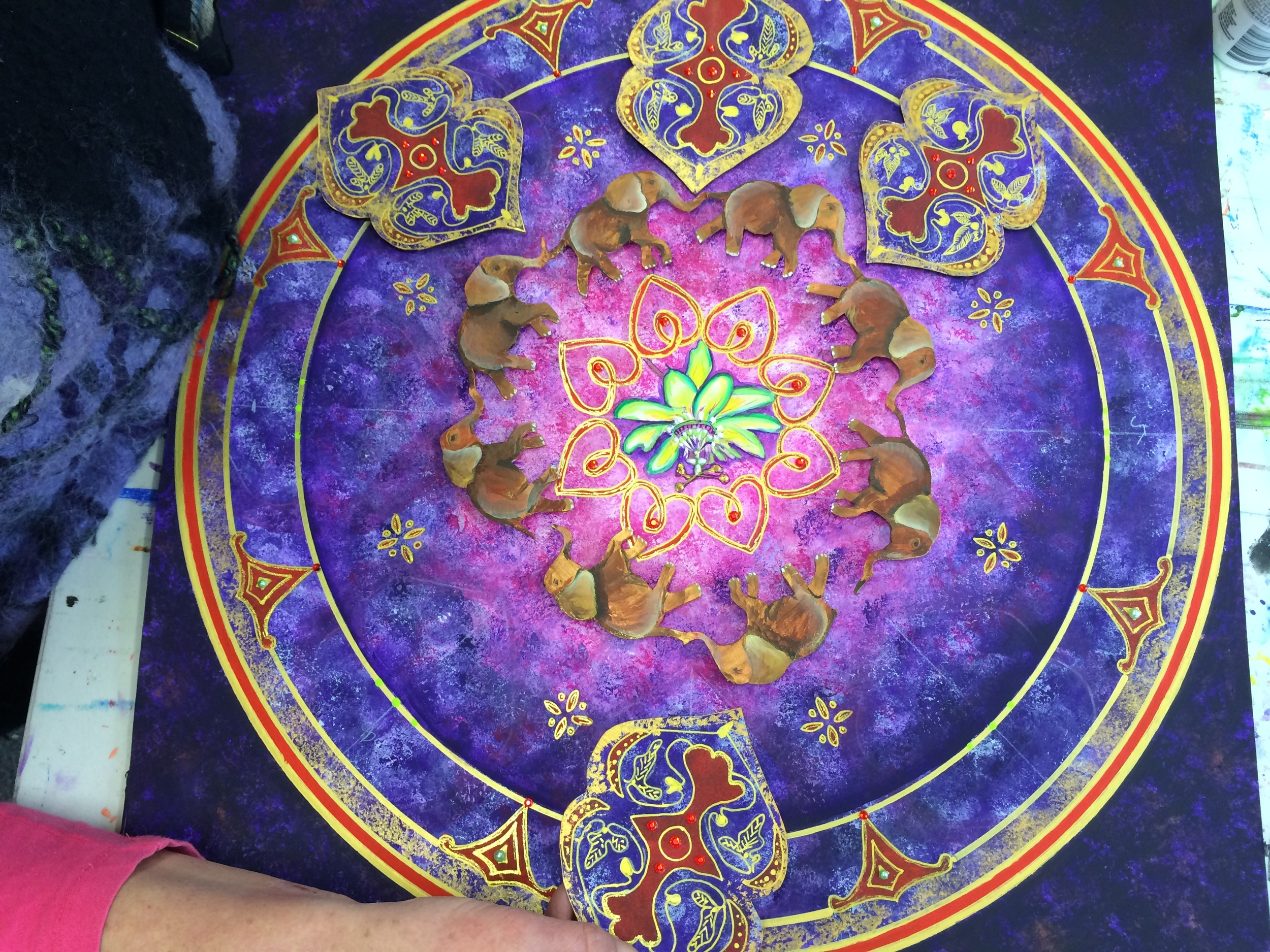 Tiffany working on a mandala