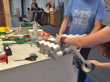 Students building an instrument