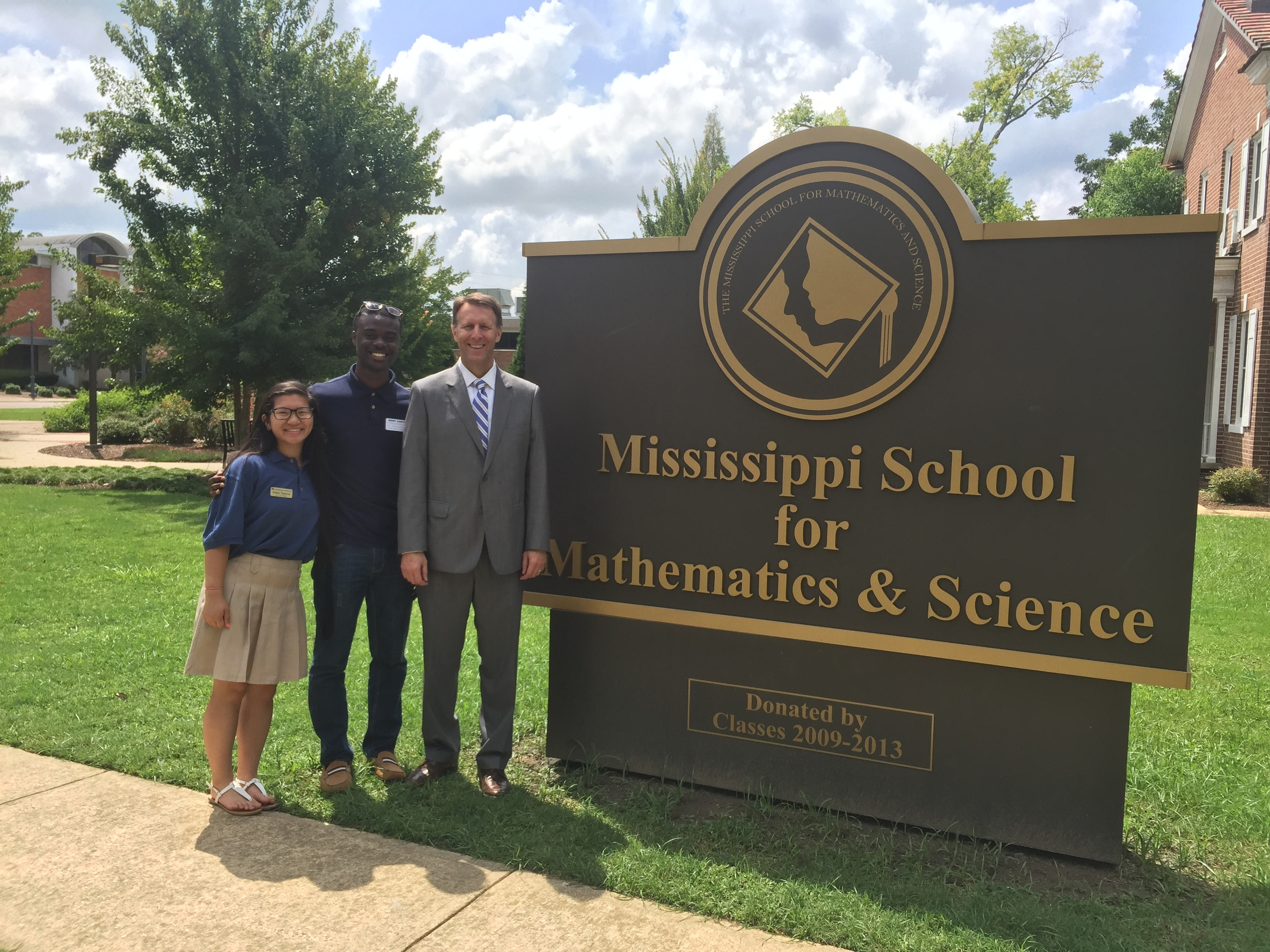 Mississippi Senator Gray Tollison is pictured here with MSMS senior Jenny Nguyen and 2013 MSMS grad Demonta Morgan.