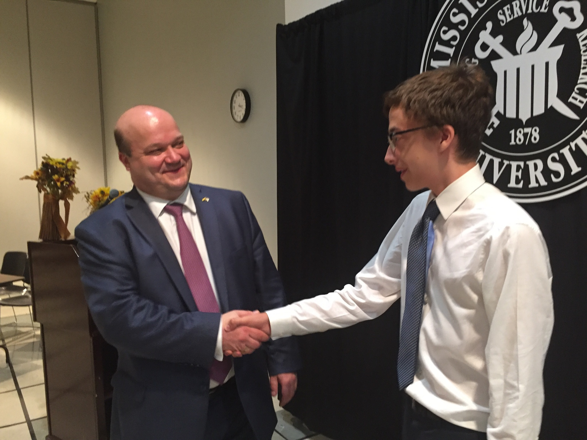 Ukrainian Ambassador to the US Valeriy Chaly shakes hands with MSMS student Liam McDougal.