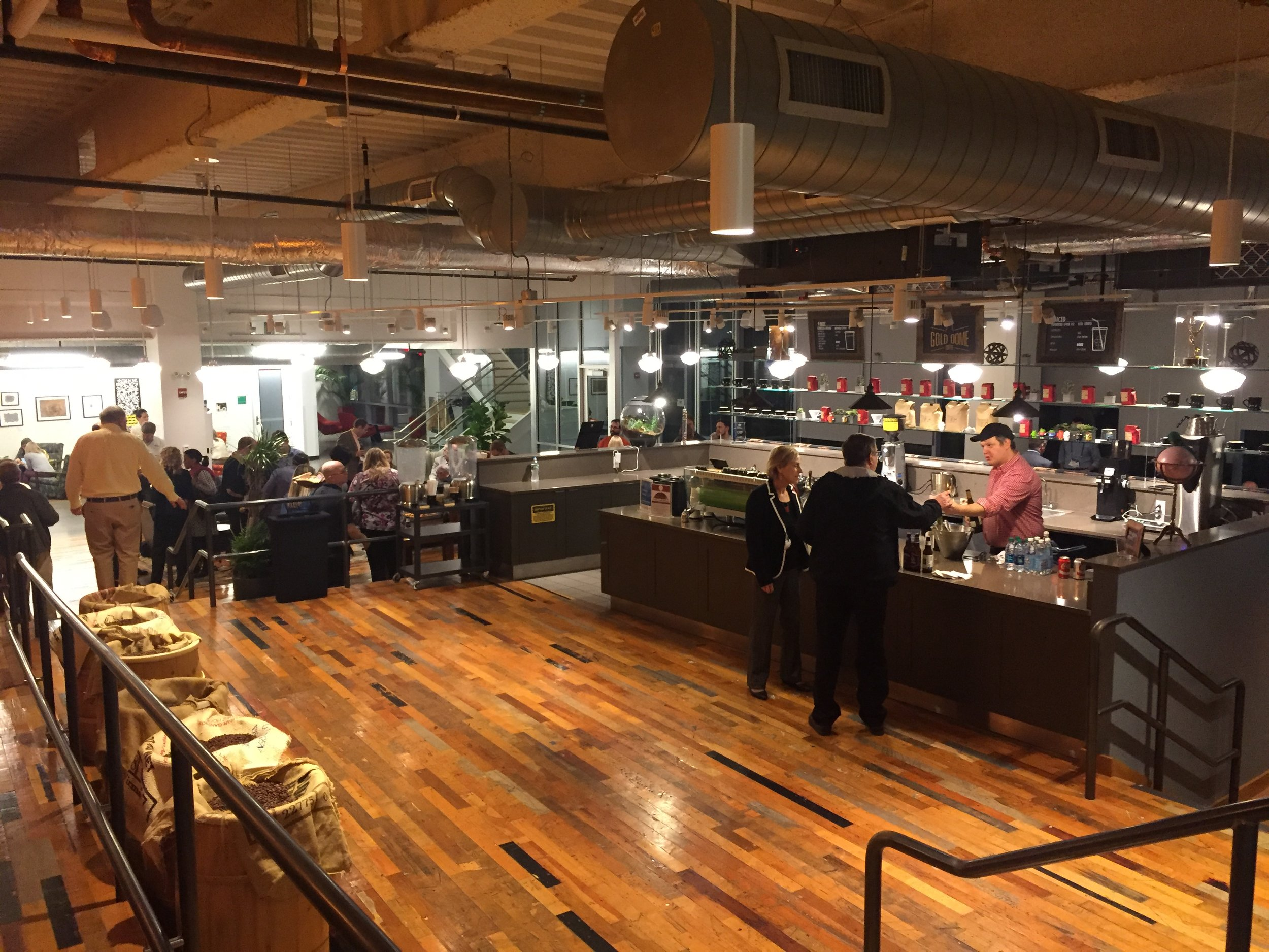 """Google Cambridge's coffee bar where employees are encouraged to """"collide and collaborate."""""""
