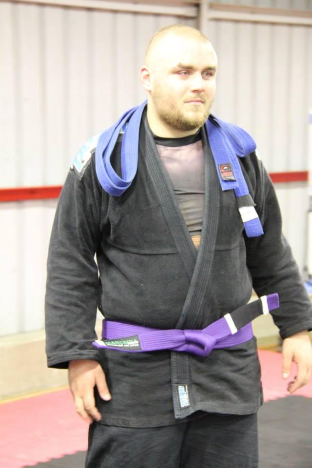 Kieryn in his new Purple Belt.