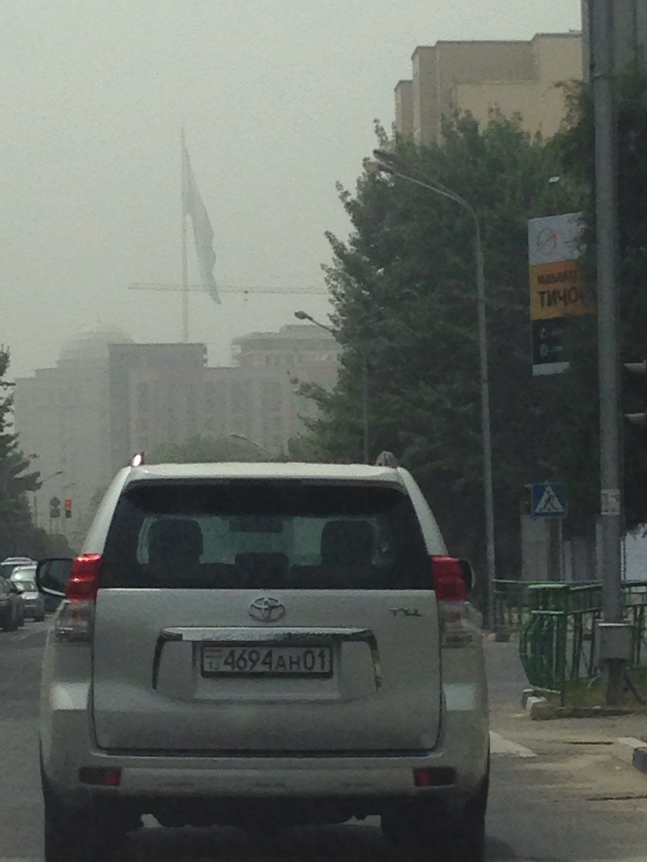 Dust in the air - ignore the image quality - snapped from the car at a red light. In the distance, you can barely make out the world's second largest flagpole.