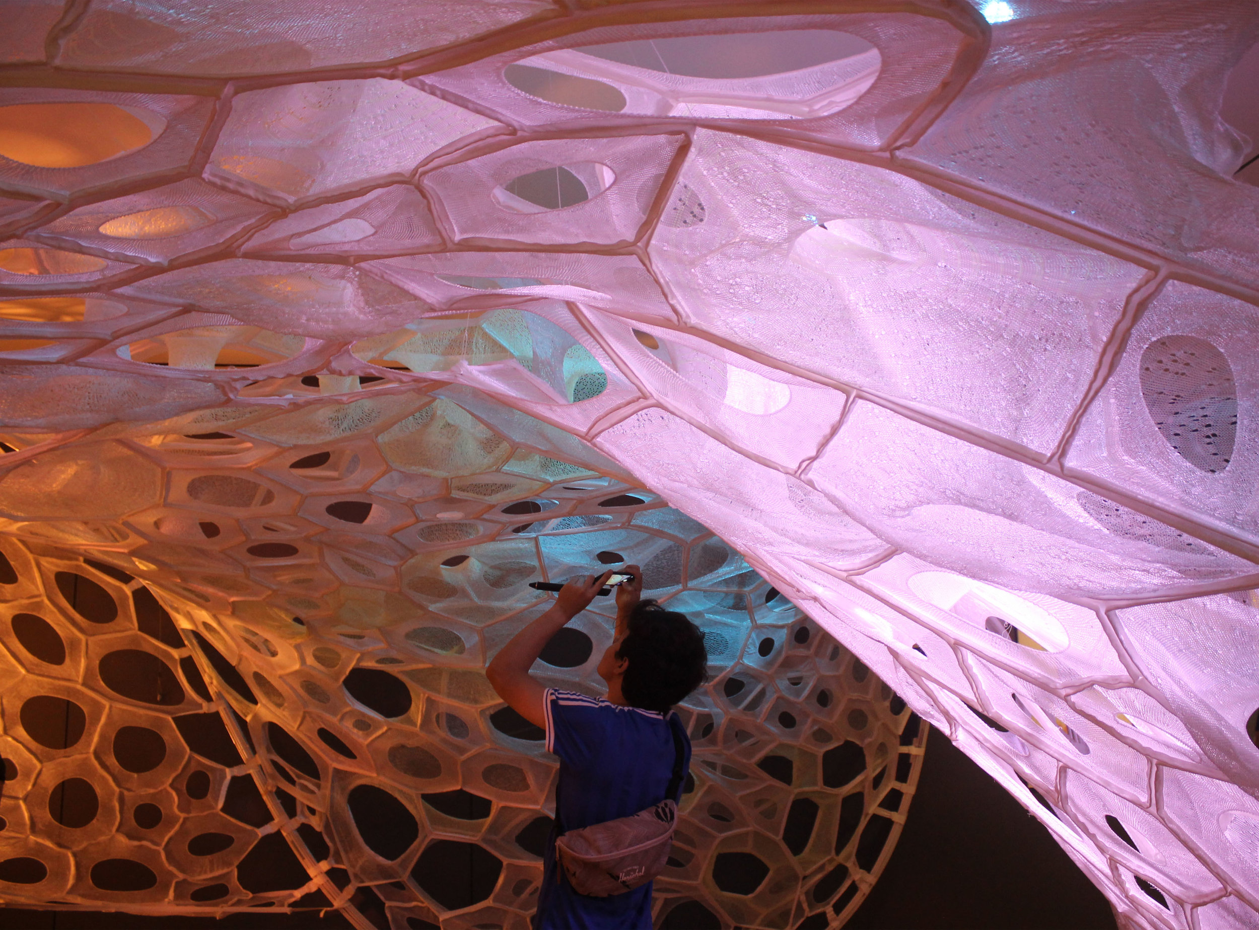 Jenny Sabin Installation.  A light-absorbing knitted textile pavilion at Copper Hewitt Design Museum in New York City, 2017