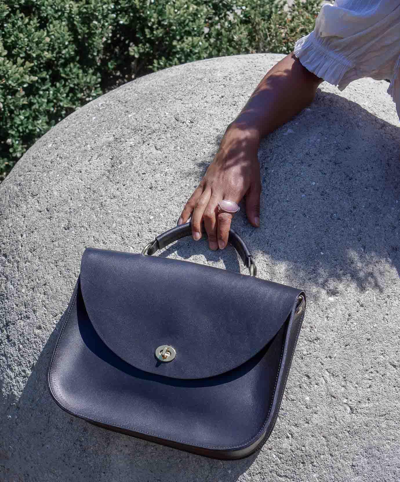 black mabel no strap with rock.jpg