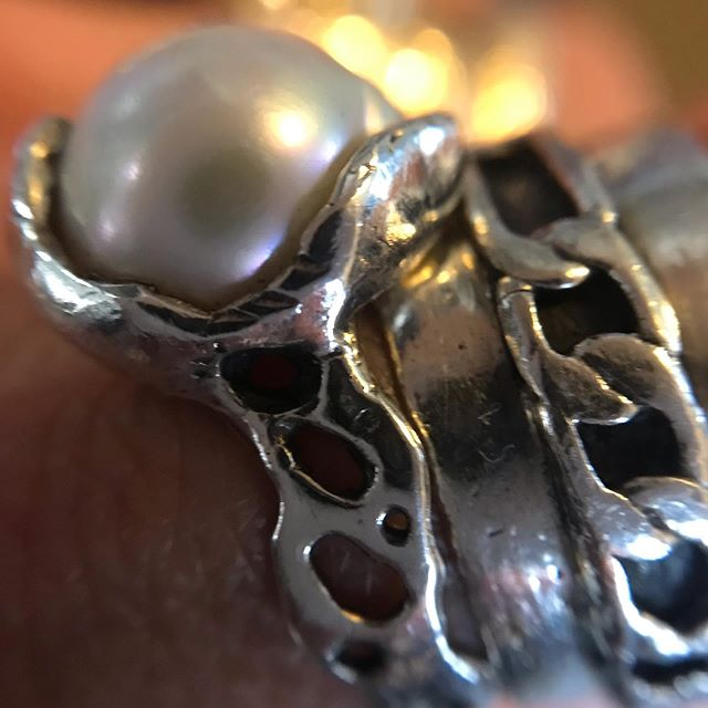 up close & personal  Pearls symbolize Purity, Spiritual Transformation, Charity, Honesty, Wisdom and Integrity, all the best within us. Pearls provide a clear vehicle for the advancing states of wisdom, as well as a clean channel for receipt of spiritual guidance. Pearls can stimulate your femininity with self acceptance. They lift your spirits and make you feel calm and beautiful. They remind us to walk with Dignity.  #pearls #pearlring #chainring #heavymetaljewelry #witchythings #witchesofinstagram #notyourmotherspearls #metaphysicalhealing #magick #talismans #paganjewelry #jewelrylosangeles #riojeweler
