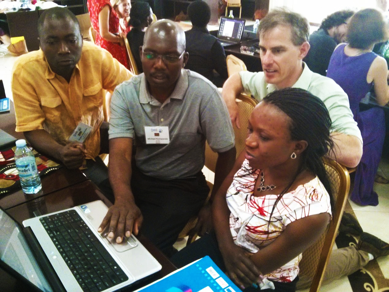 One of the developers of Bloom, John Hatton, looks on as workshop participants utilize Bloom at the Peace Corps Africa Literacy Workshop.