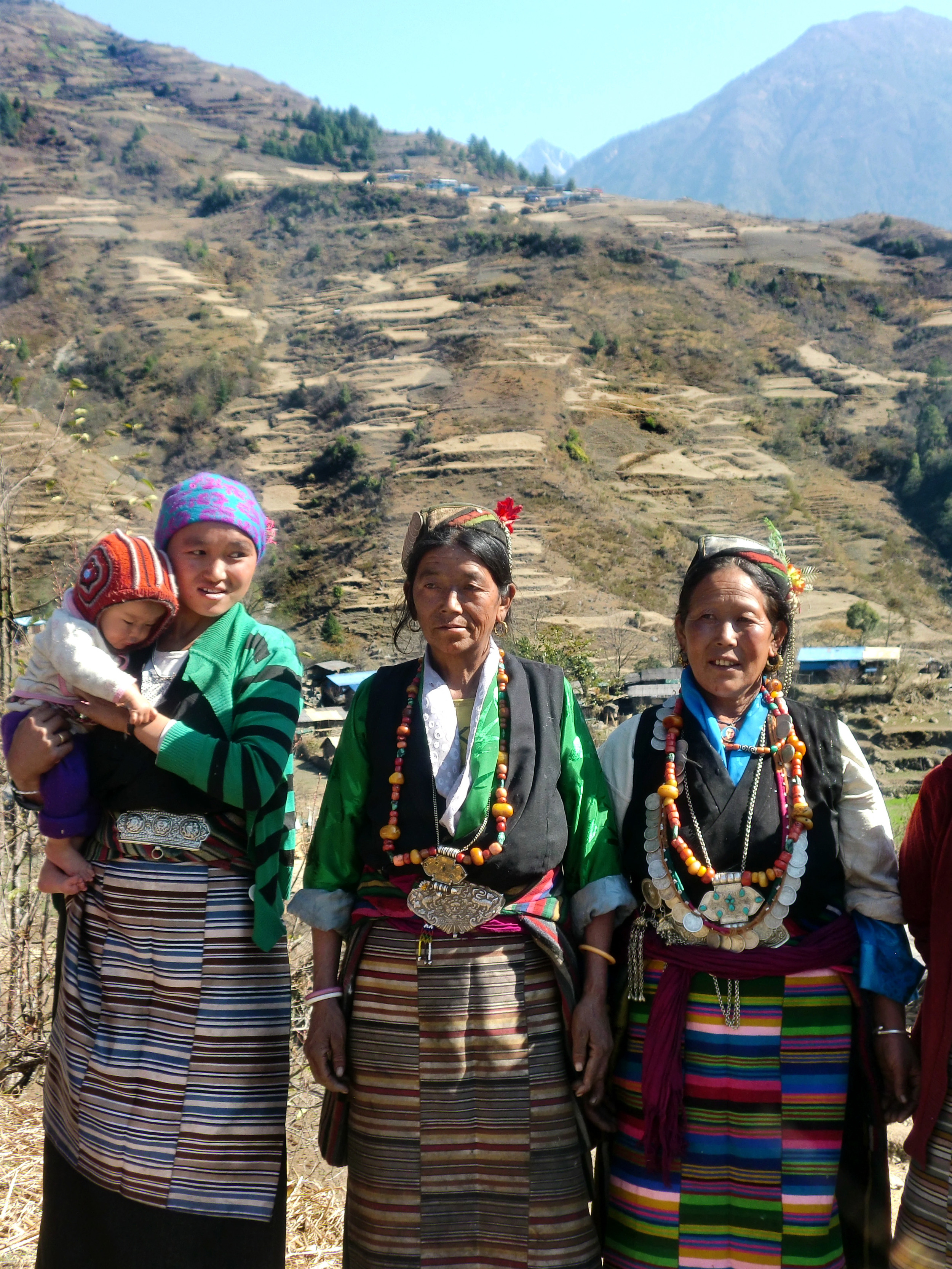 Three lovely Lhomi women wearing their tradition dress.