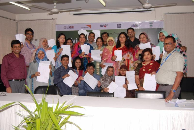 Participants in the Enabling Writers workshop in Bangladesh display their creations.