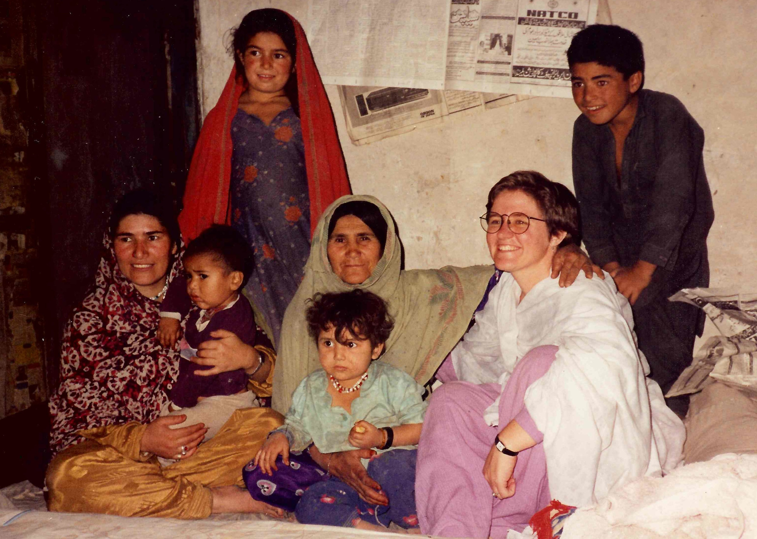Clare with a minority language family from a remote mountainous region where she was doing sociolinguistic research in 1990