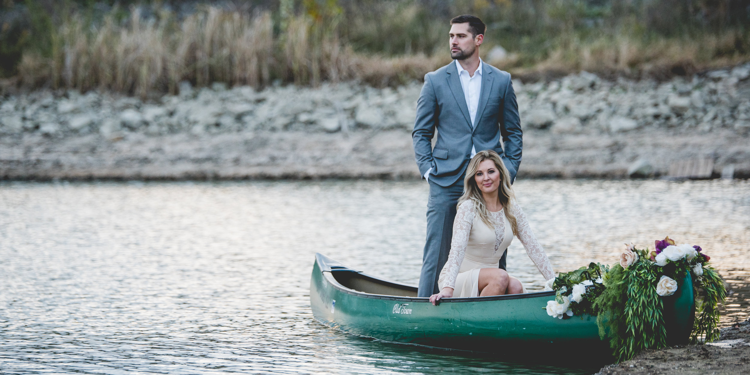Bride and Groom in a Canoe By Brett Loves Elle Photography, Columbus Wedding Photographers.