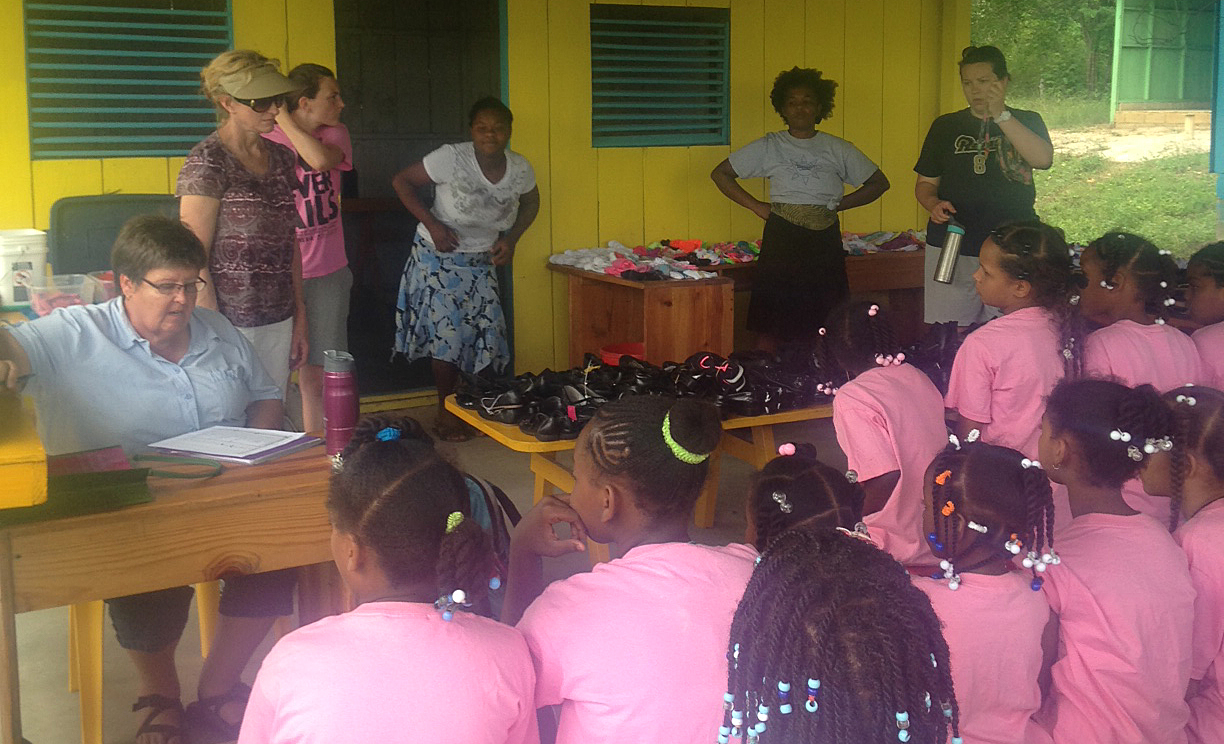 The girls were so excited to get their shoes! The women on our team, along with some Dominican ladies (mainly moms), helped to fit them for new shoes that they will wear to school.