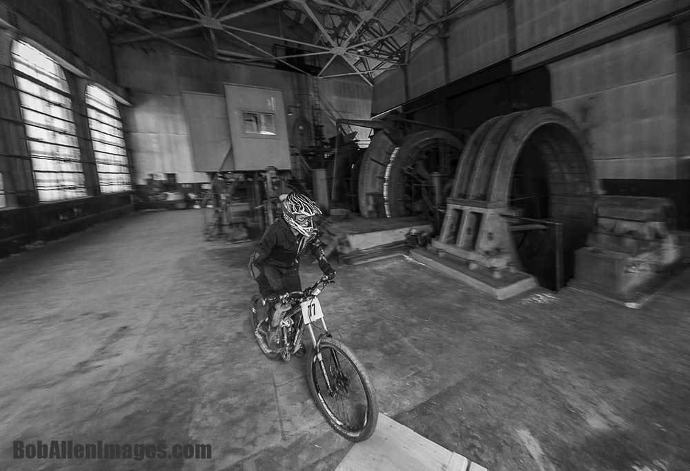 A racer rolls through the historic Con Mine in the Evel Urban Downhill in Butte America.