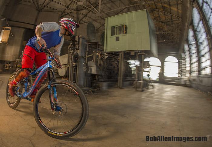 John Faunce pre-rides the Evel Urban Downhill course through The Con mine's motor room.