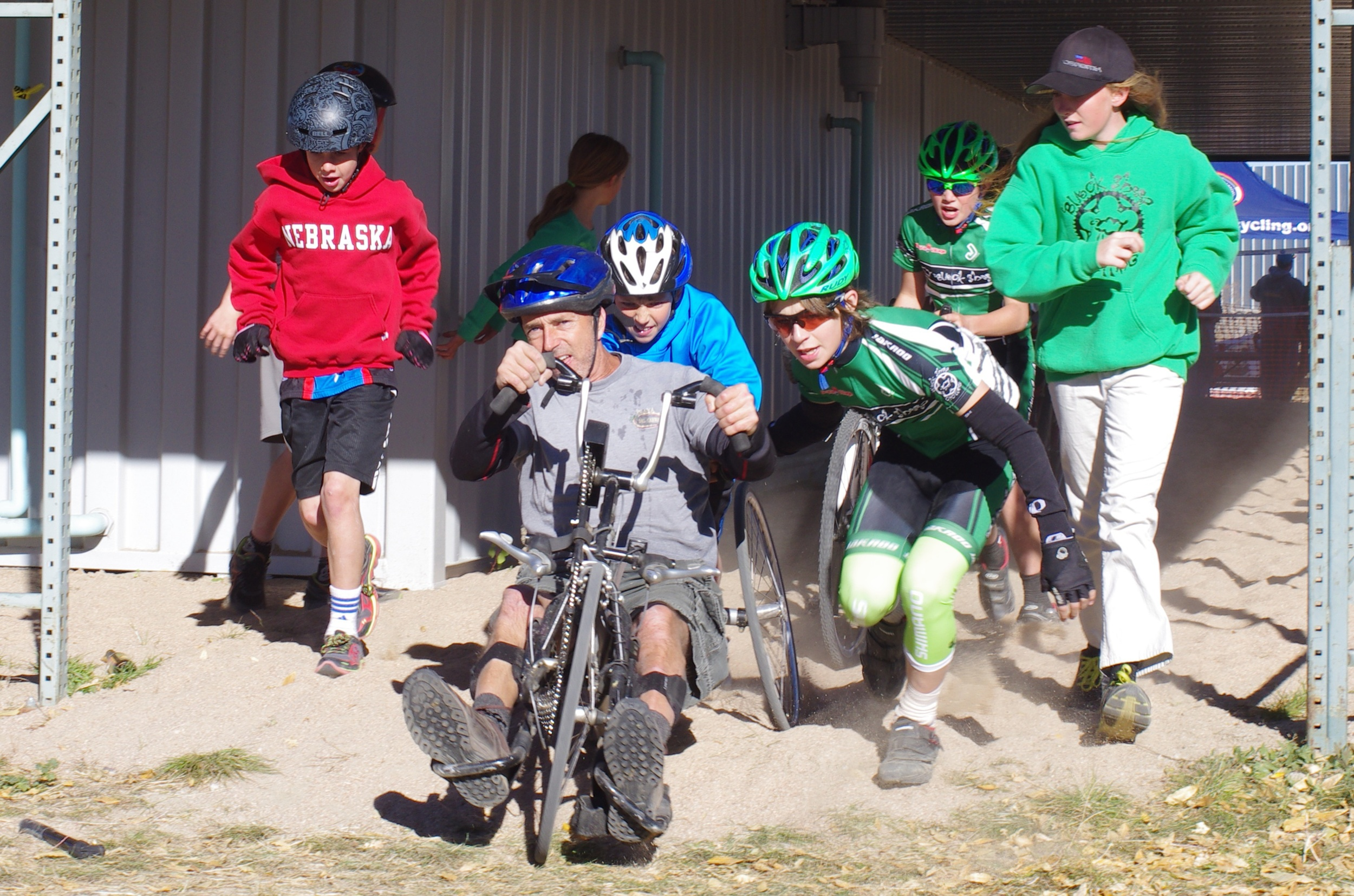 Kids helping the Adaptive class through the sand. Very cool!
