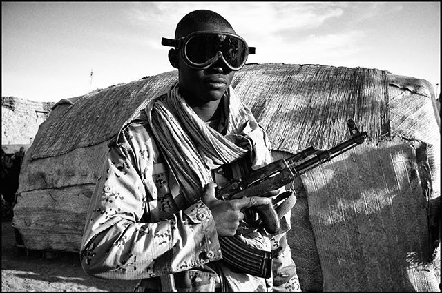 When we went into the Saharan desert in Mali, in 2012, right after hell broke loose in the region, covering the kidnapping of 4 Europeans. The condition of letting us in, was to have 20 armed soldiers accompany us.   Near Timbuktu, Mali #desert #soldier #sahara #saharadesert #journalism #timbuktu #mali #africa #canon5d #canon