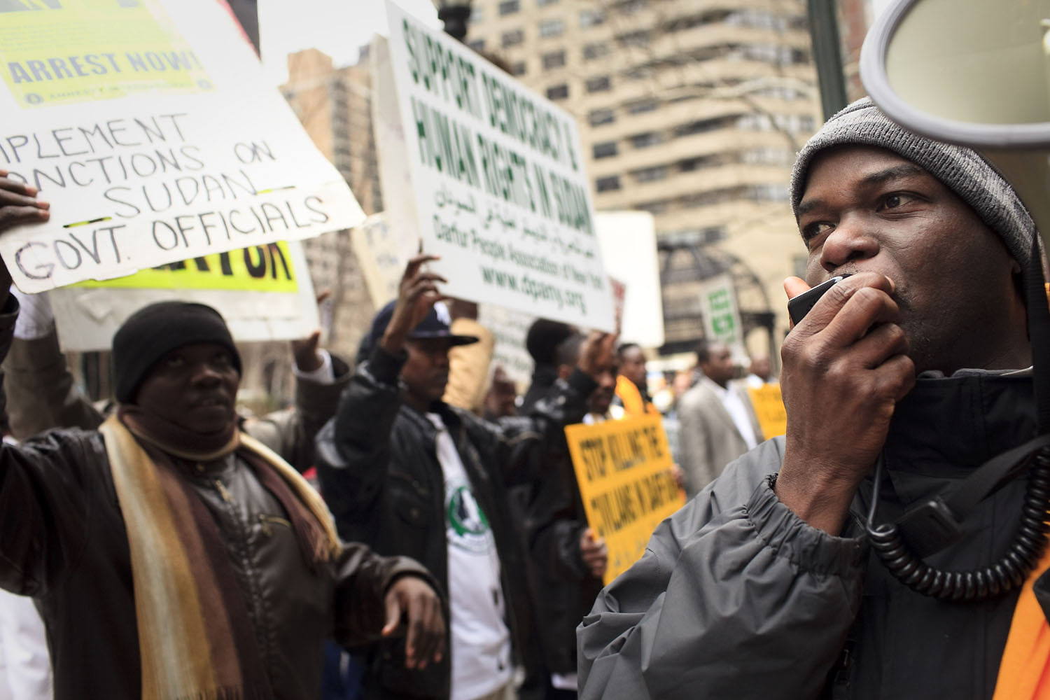 Members of the Darfurian community protest against the Sudanese government near the United Nations.