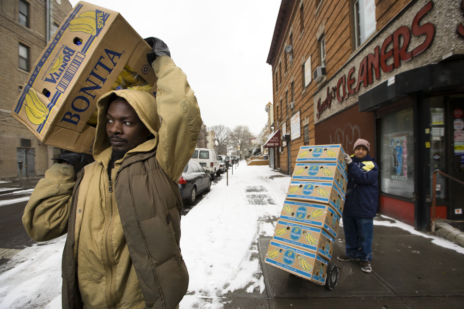 Ahmat Nour, president of the Darfur People's Association of New York (DPANY), delivers bananas to a bodegas and grocery stores off Coney Island Ave. in Brooklyn.