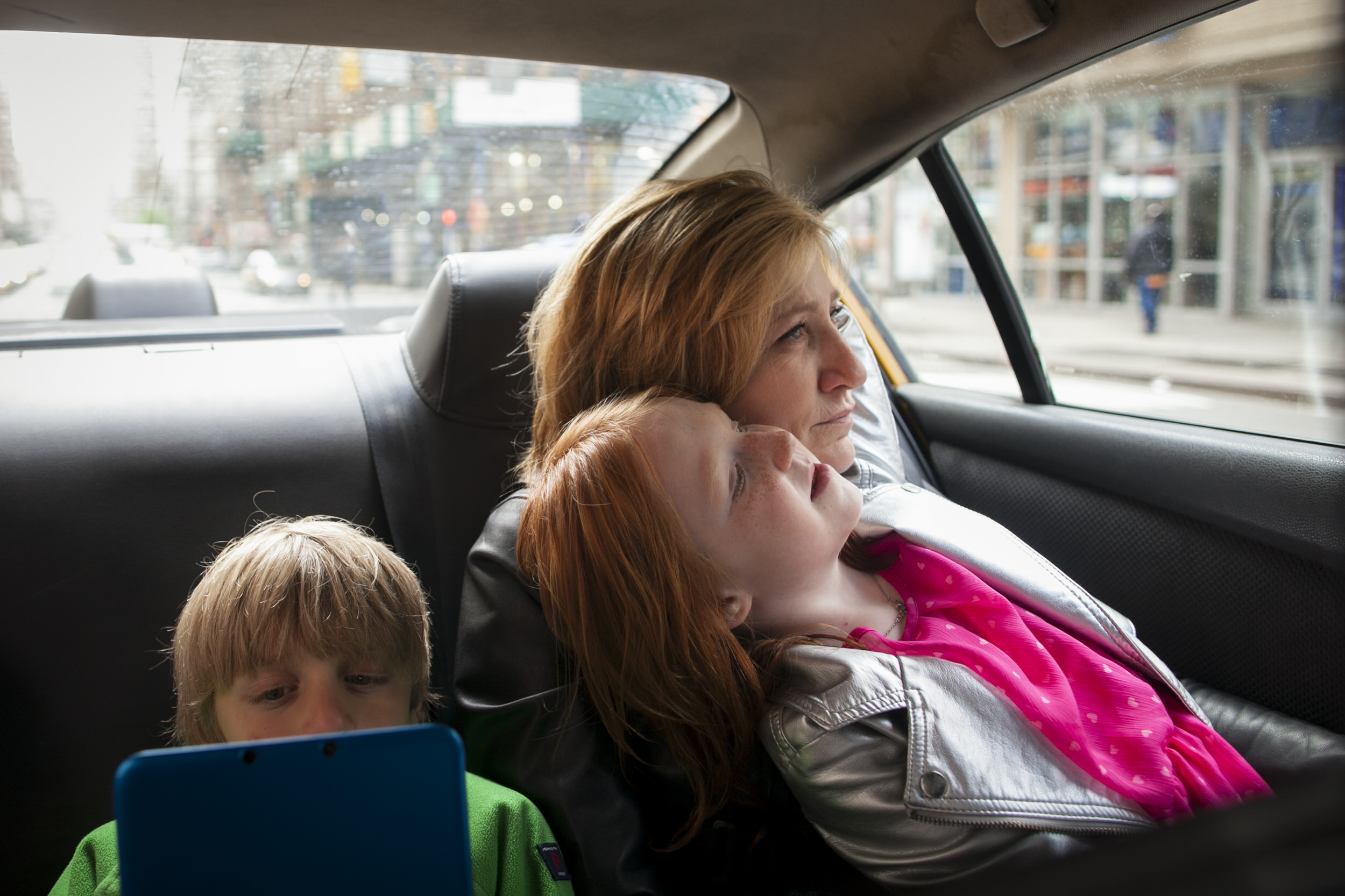 Actor Edie Falco in a taxi with her children Anderson and Macy.