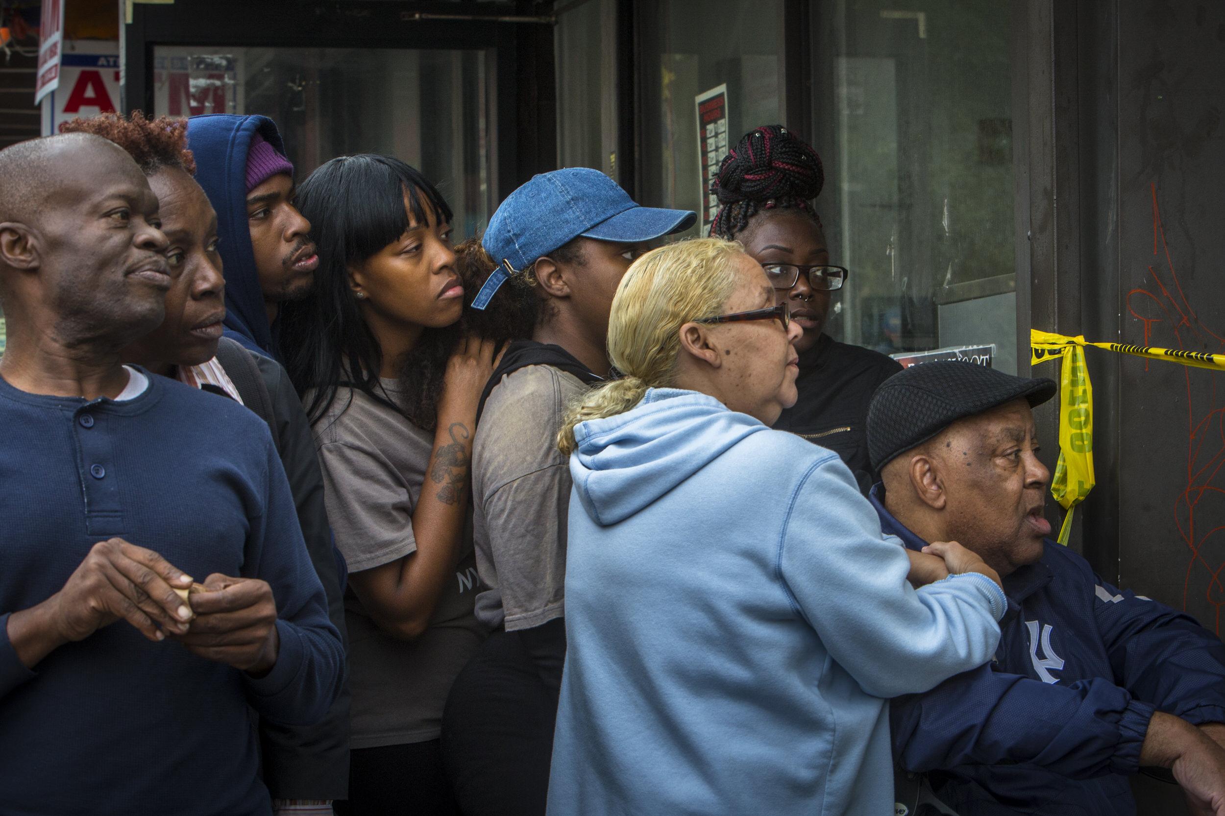 Onlookers following a police shooting in Bedford-Stuyvesant, Brooklyn.