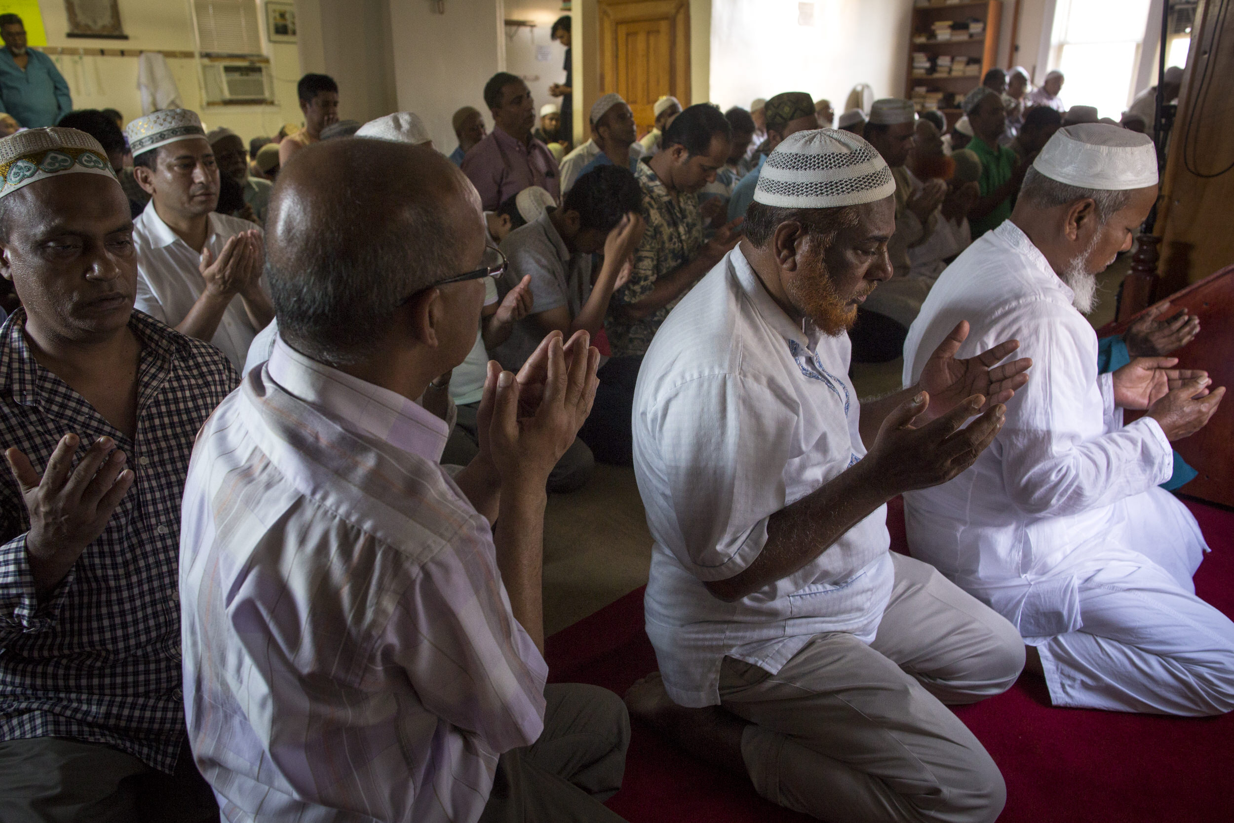 A prayer service at Al-Furqan Jame Masjid mosque in Ozone Park, Queens a few hours after the mosque's imam and his assistant were shot and killed on the street after leaving an earlier service.
