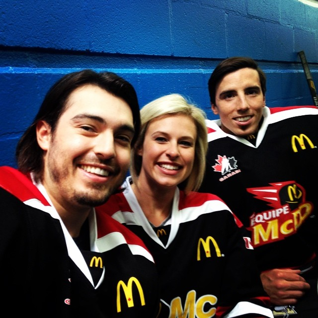 LA Kings' defenseman Drew Doughty, Tessa and Pittsburgh Penguins goalie Marc Andre Fleury on the set of their McDonald's Canada youth hockey initiative in August 2014.