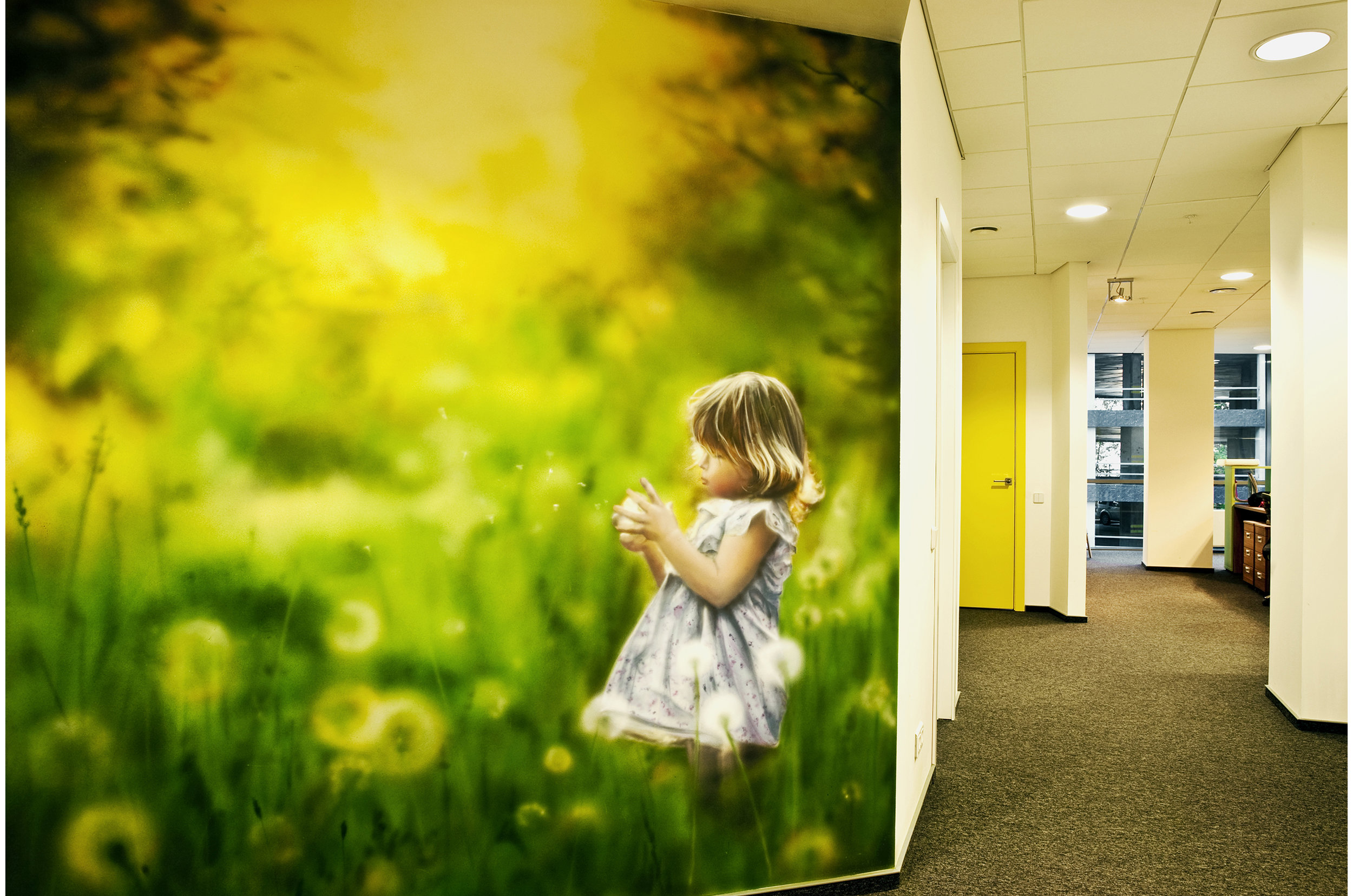 Office entrance area. Decorative mural