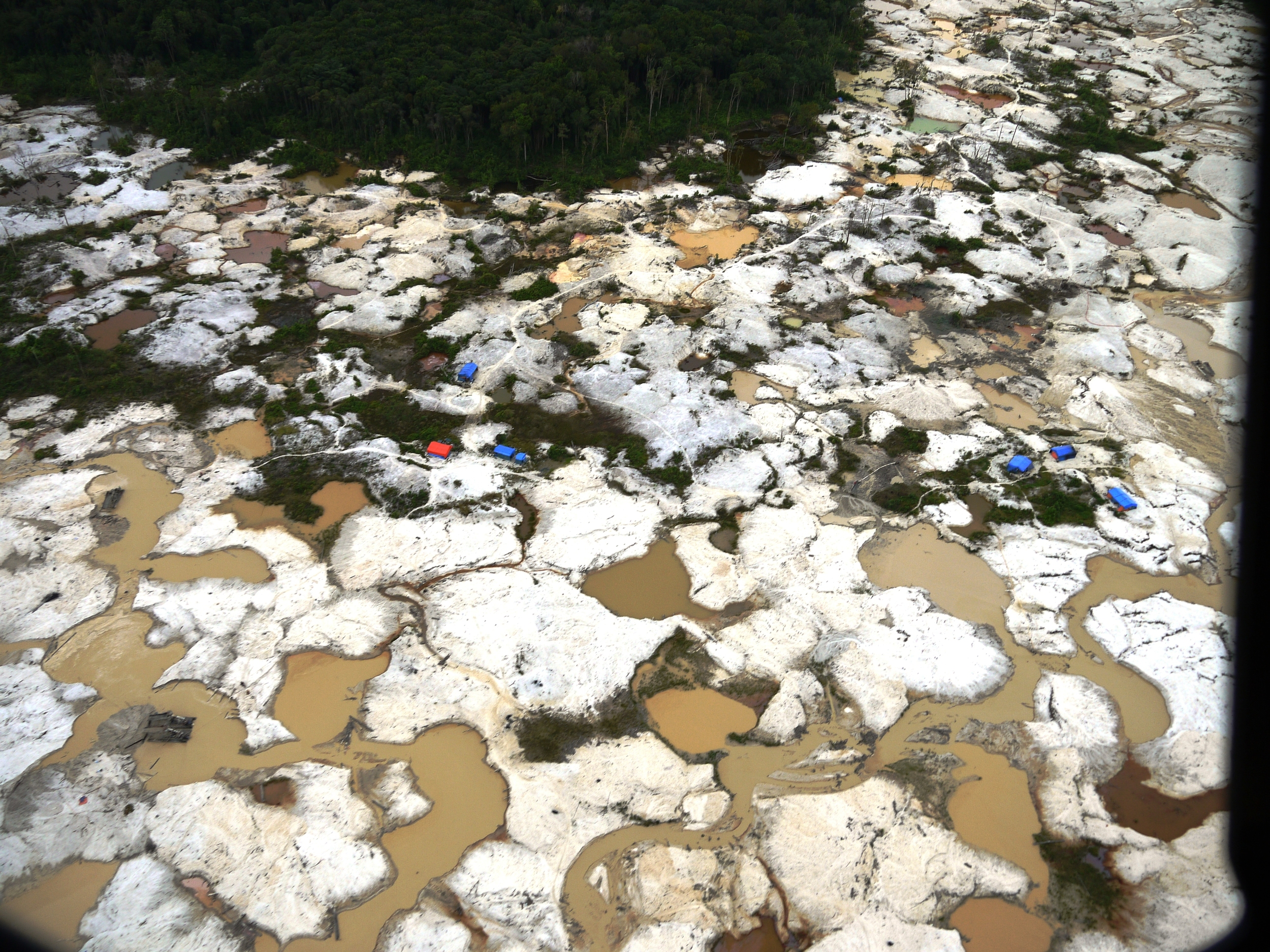 Mining moonscape... illegal gold mining in Sumatra, Indonesia (photo by William Laurance)