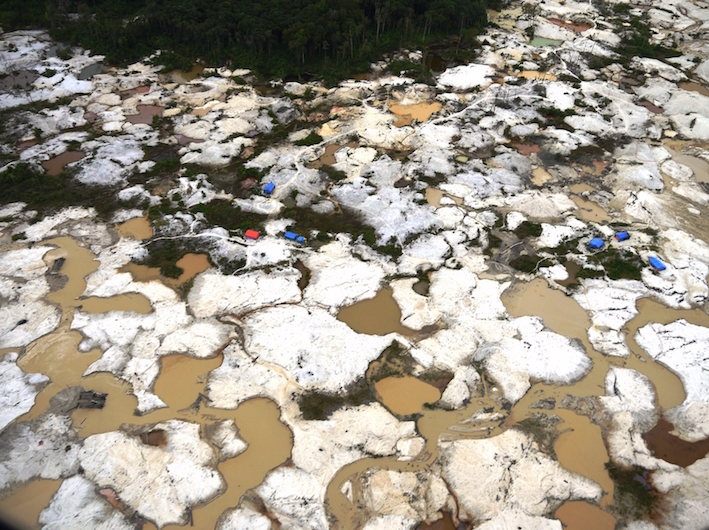 Illegal gold miners ravage a river in central Sumatra  (photo by Bill Laurance)