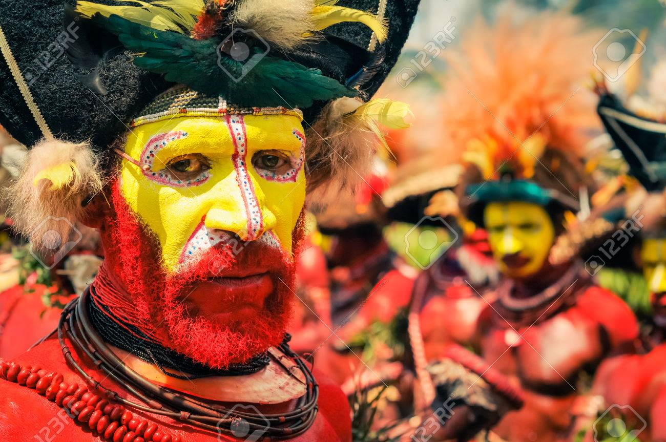 57064876-wabag-papua-new-guinea-august-2015-native-man-with-red-and-yellow-colour-on-his-face-and-body-looks-.jpg