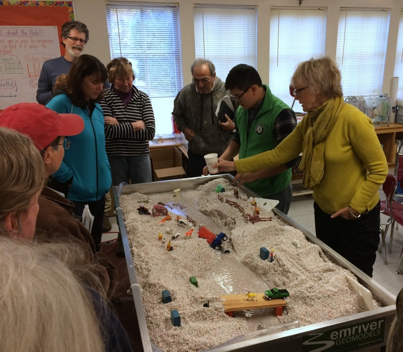 The Saxtons River Watershed Collaborative used a stream table to demonstrate river behavior at schools, town meetings, and community events. Credit: Windham Regional Commission.